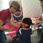 "Joe worked the ""Pin the Nose on the Clown"" booth at the Mini Feria."