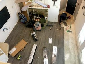 Installing laminate floors.